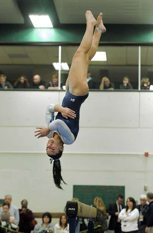 Cydney Crasa dismounts off the balance beam during