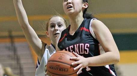 Friends Academy's Kristina Kim gets the layup while