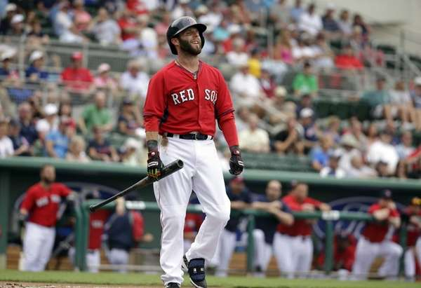 Boston Red Sox's Dustin Pedroia smiles after swinging