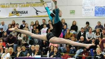 Miranda Lund performs her floor routine during the