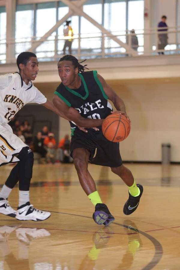 Farmingdale's Curtis Jenkins drives past Uniondale's Imran Ritchie
