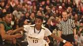 Uniondale's Imran Ritchie drives past Farmingdale's Rah-Quell Rogers