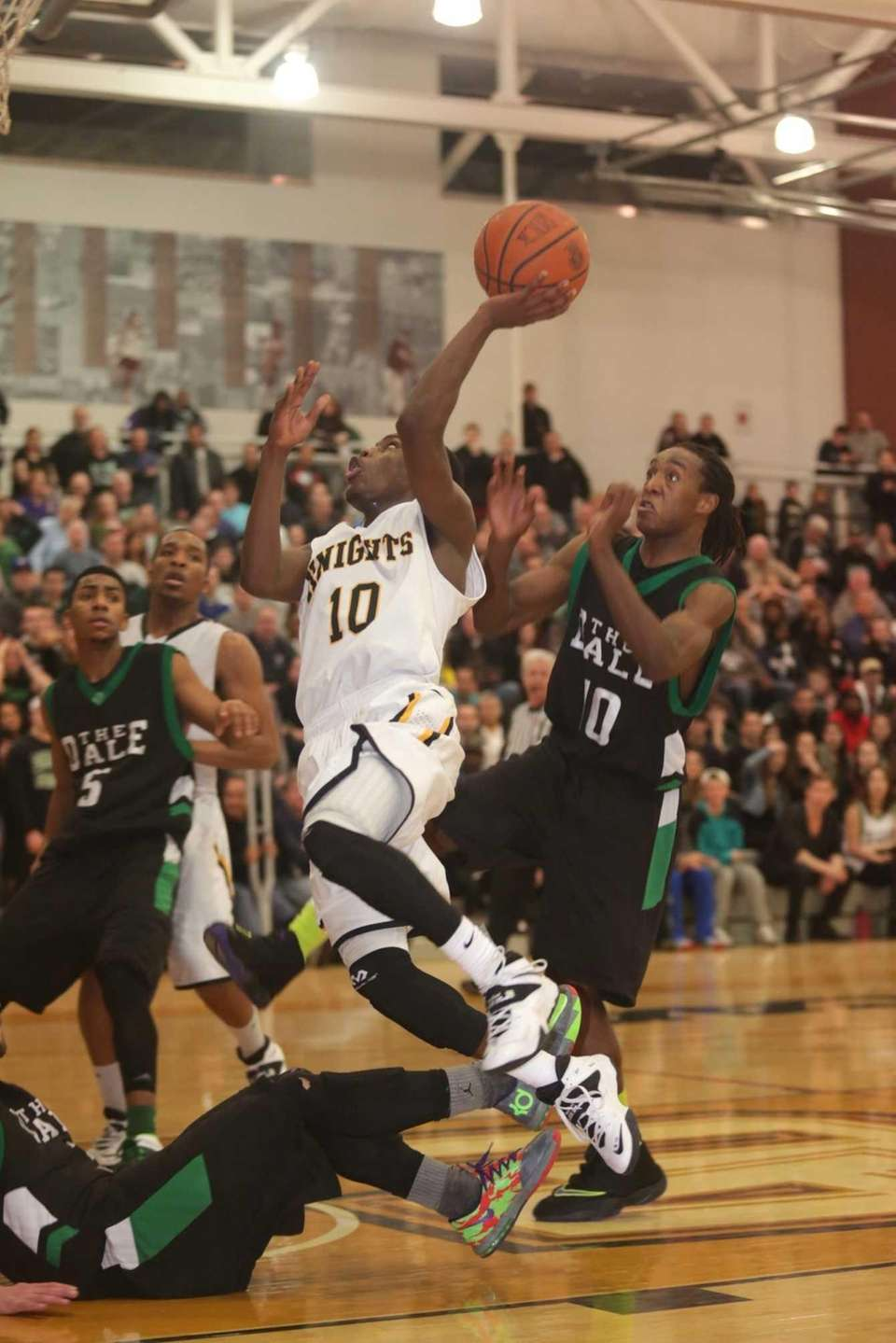 Uniondale's Shomari Redd scores two points late in