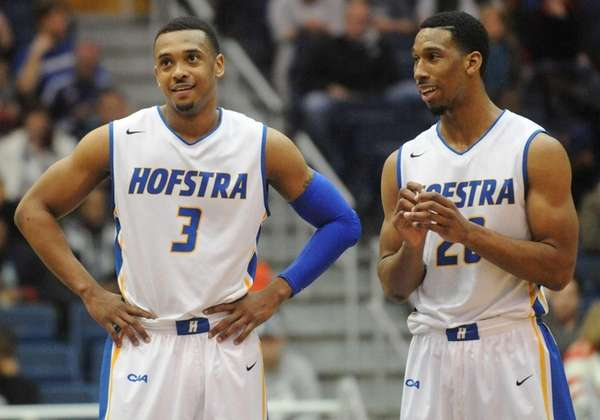 Hofstra's Zeke Upshaw, left, and Jamall Robinson react