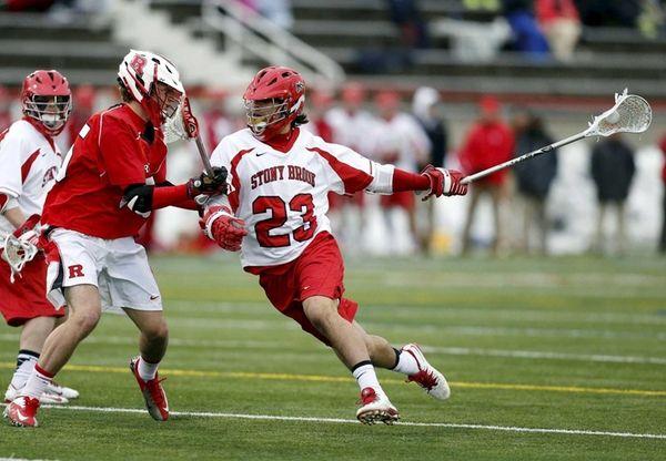 Stony Brook's Challen Rogers runs around Rutgers' Chris
