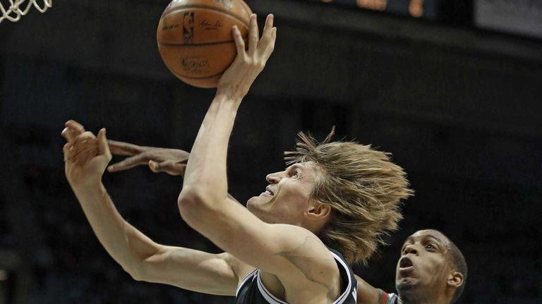 Nets' Andrei Kirilenko puts up a shot against
