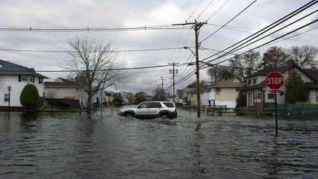 A SUV crossing Ocean Avenue in Freeport where