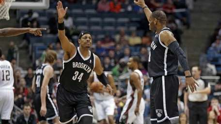 Nets' Marcus Thornton, right, and teammate Paul Pierce