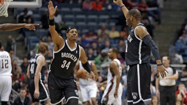 Nets' Marcus Thornton, right, and teammate Paul Pierce