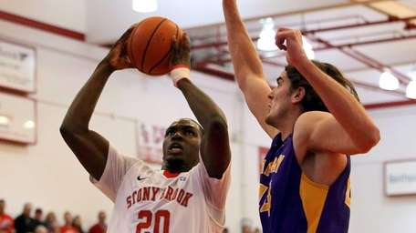 Stony Brook's Jameel Warney drives the lane for