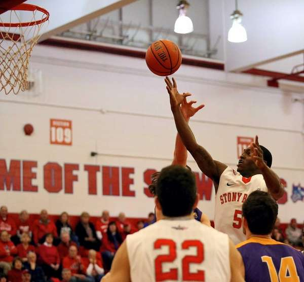 Stony Brook's Dave Coley puts the layup over