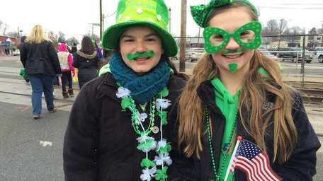 Girl Scouts Amanda Marroquin, 12, of Bethpage, left,