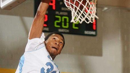 St. Mary's Christopher Coalman slam dunks for two