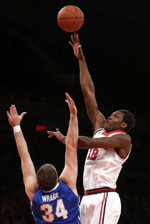 St. John's Chris Obekpa shoots over Creighton's Ethan