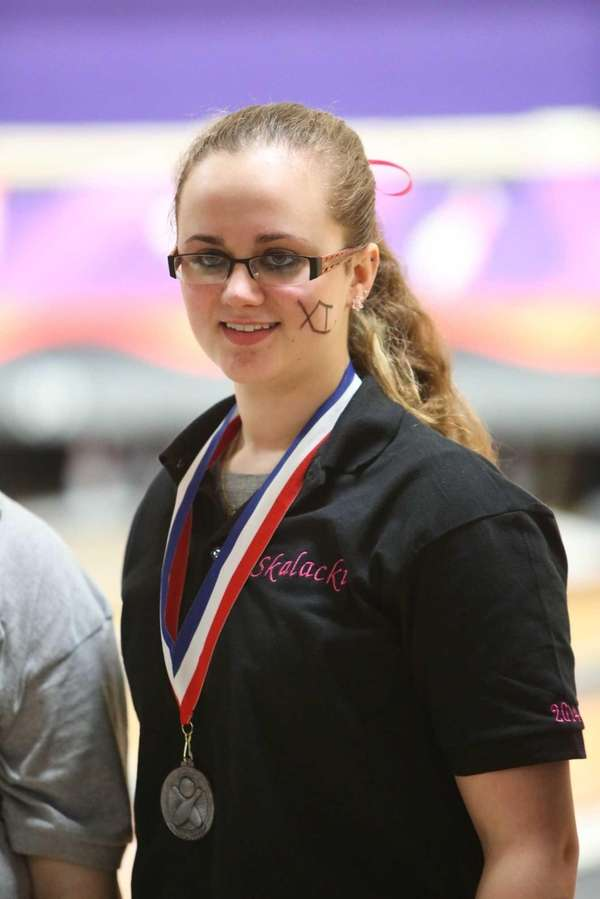 Middle Country's Kelly Skalacki smiles with a medal