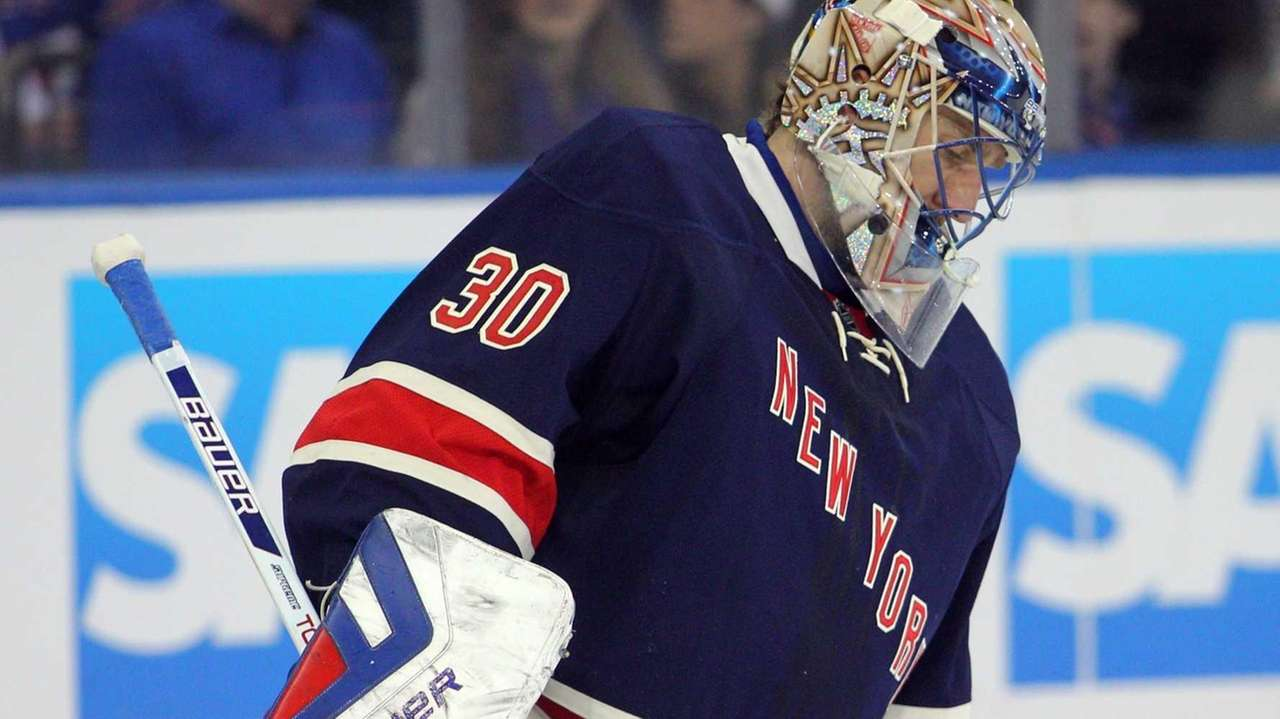 Henrik Lundqvist reacts after allowing a goal to