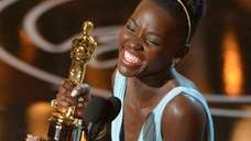 Lupita Nyong'o accepts the award for best actress