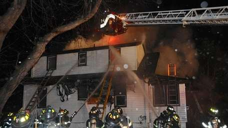 Two firefighters suffered minor injuries early Monday while