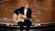 Host Ellen DeGeneres onstage during the Oscars at