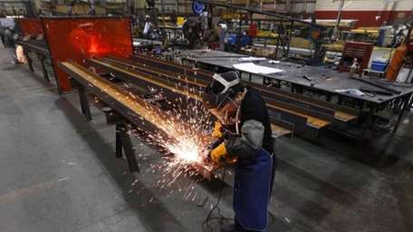 Jesus Rodriguez grinds steel at the IDEAL Group