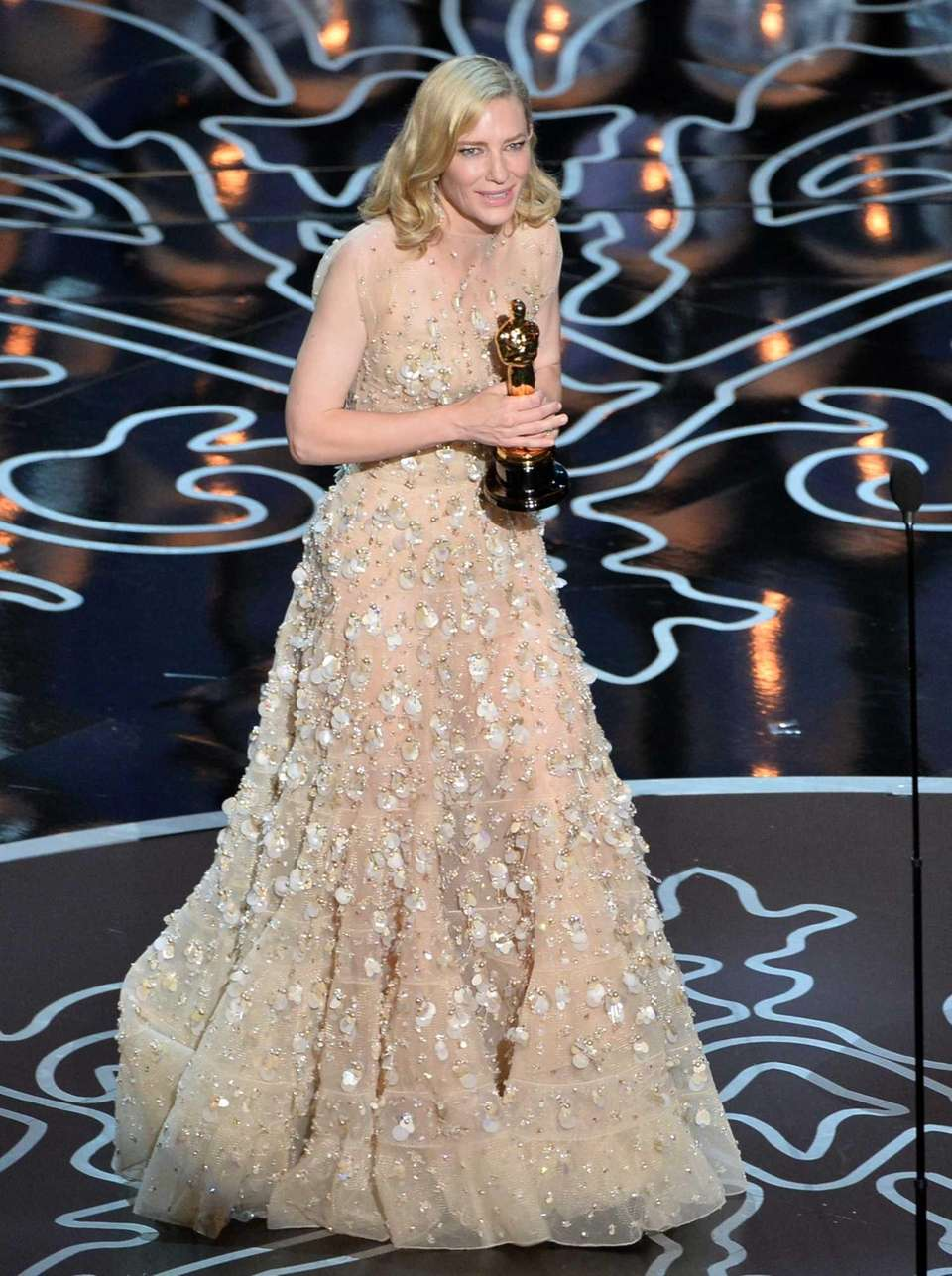 Actor Cate Blanchett, accepting the Oscar statuette she