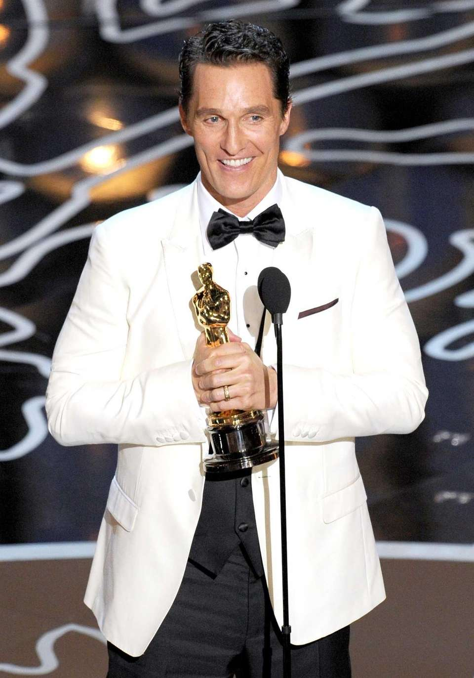 Matthew McConaughey accepts the Oscar statuette for Best