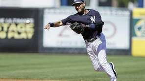 Derek Jeter throws to first base to put