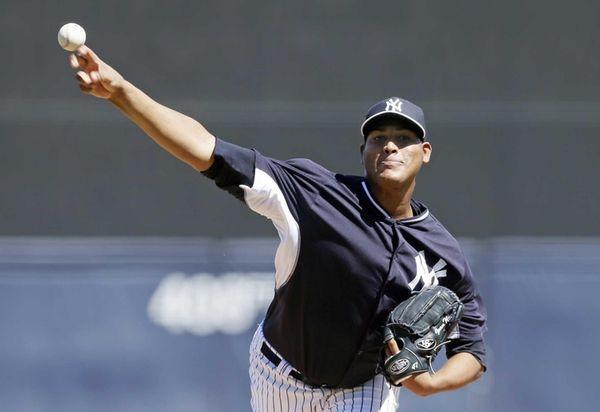 Yankees starting pitcher Ivan Nova throws during the