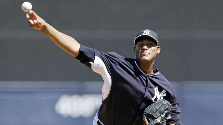 Yankees starting pitcher Ivan Nova throws during the