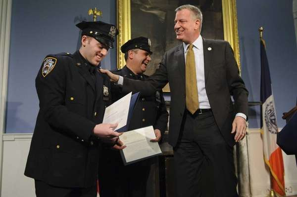 New York City Police Officers David Roussine, left,