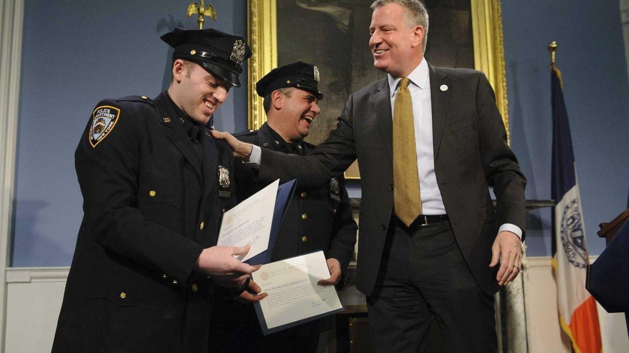 New York City Police Officers David Roussine, left,