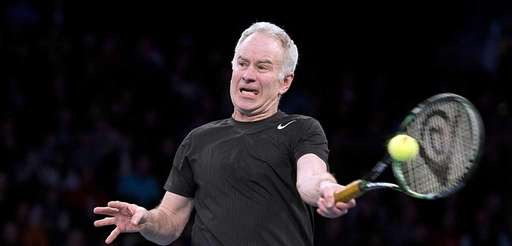 John McEnroe hitting a forehand volley against Bob