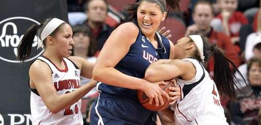 Connecticut's Stefanie Dolson, center, battles Louisville's Tia Gibbs,