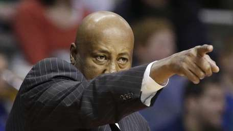 Mike Woodson points during the second half of
