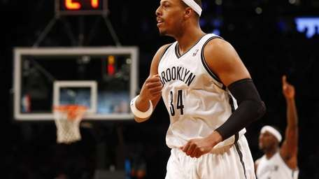 Paul Pierce of the Brooklyn Nets reacts after
