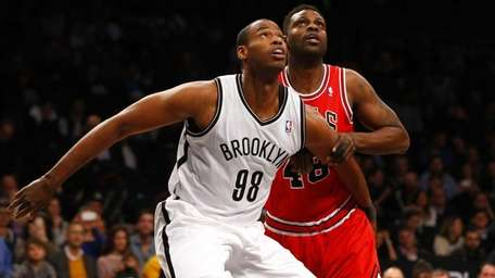 Jason Collins of the Brooklyn Nets defends against