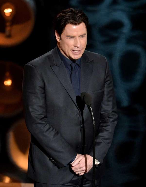 Actor John Travolta speaks onstage during the Oscars