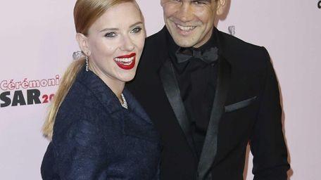 Scarlett Johansson arrives with her fiance Romain Dauriac