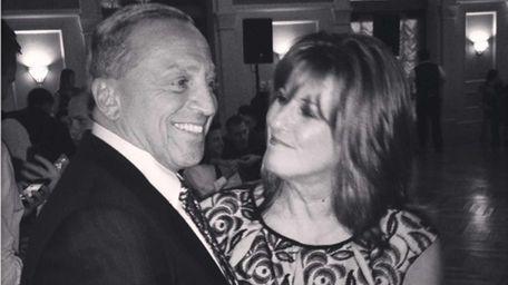 Lawrence Passaretti and Kate Corso-Passaretti at a function