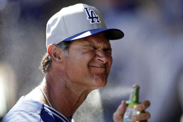 Los Angeles Dodgers manager Don Mattingly sprays on