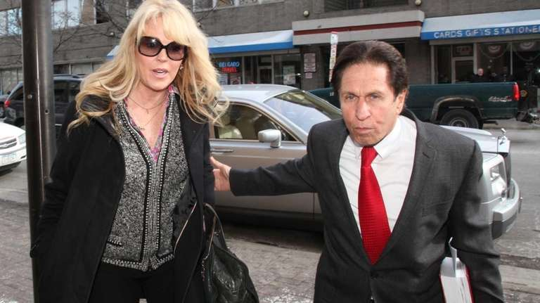 Dina Lohan and her lawyer outside First District