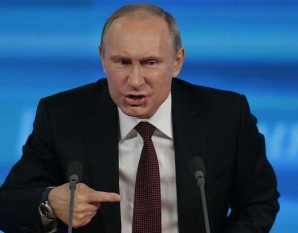 Russian President Vladimir Putin gestures while speaking at