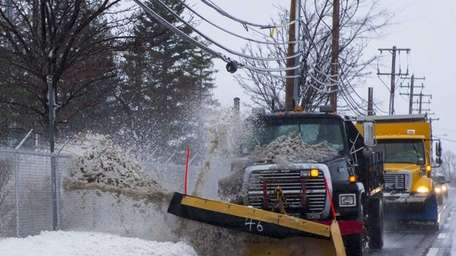 Plows clear snow and slush as they travel