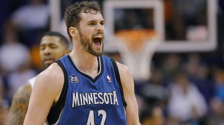 Minnesota Timberwolves forward Kevin Love (42) yells after