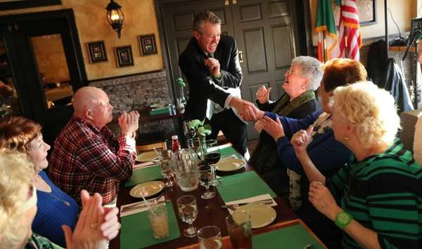 Flanagan's Pub owner David Crowe greets patrons at
