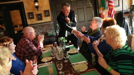 Flanagan's Pub owner David Crowe greets patrons at