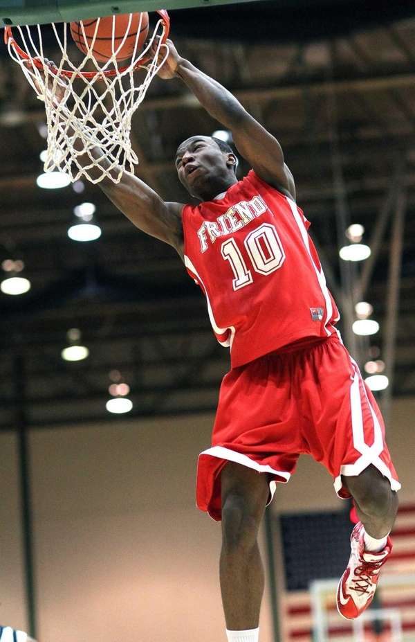 Friends Academy's Tyrone Perkins goes for the dunk