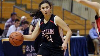 Friends Academy's Kristina Kim drives toward the net