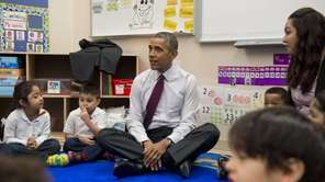President Barack Obama sits with children during a