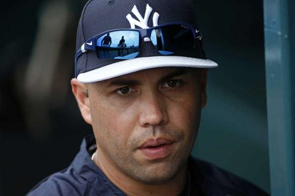 Carlos Beltran stands in the dugout at McKechnie